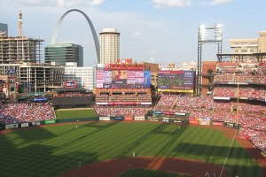 St. Lous  skyline and Arch from behind home plate at Busch Stadium  with shadows on the field - June 1, 2019
