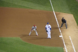 Anthony Rizzo keeps the runner close to first.